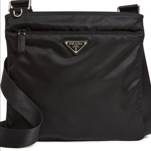 Sleek nylon bag with the iconic triangle Logo